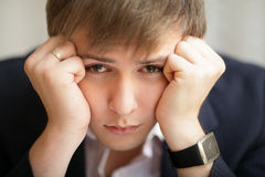 Stressed tired pensive businessman Royalty Free Stock Image
