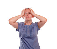 Stressed and tired young woman with headache Stock Images