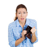 Stressed unhappy young woman, with an empty wallet Royalty Free Stock Photos