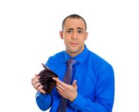 Stressed upset sad unhappy man standing holding empty wallet Stock Image