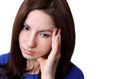 Stressed woman. Young brunette girl looking depressed isolated on white background Stock Photos