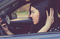 Stressed woman with alarm clock in a car royalty free stock images