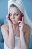 Stressed Woman in Bath Towel with Cell Phone Royalty Free Stock Photography