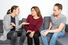 Stressed woman being angry with friends. Woman feels guilty while being accused by a friend stock photo