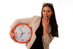 Stressed woman with big clock rushing because of being late. Stock Images