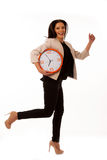 Stressed woman with big clock rushing because of being late. Royalty Free Stock Photos