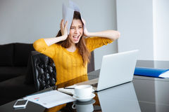 Stressed woman with bills at home Royalty Free Stock Photo