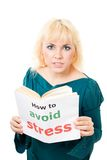 Stressed woman with book Stock Photo