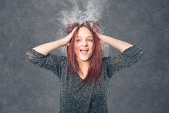 Stressed woman with burnout. And smoke head stock photography