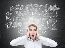 Stressed woman and business sketch, blackboard Royalty Free Stock Photos