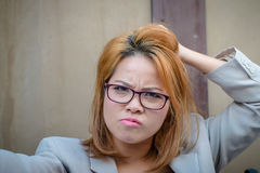 Stressed woman. Stressed businesswoman is feeling moody Stock Images