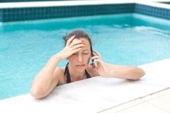 Stressed woman calling Stock Photography