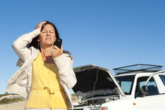 Stressed woman car breakdown Royalty Free Stock Photography