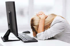Stressed woman with computer. Business, office, school and education concept - stressed businesswoman with computer at work