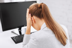 Stressed woman with computer Stock Photos