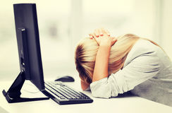 Stressed woman with computer Royalty Free Stock Photo