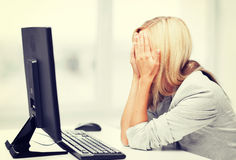 Stressed woman with computer Stock Image