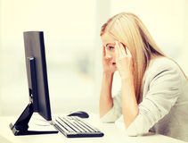 Stressed woman with computer Stock Photo
