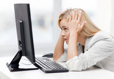 Stressed woman with computer Stock Images