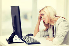 Stressed woman with computer Royalty Free Stock Photos