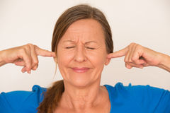 Stressed woman covering ears Royalty Free Stock Image