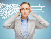 Stressed woman covering her ears with hands Stock Images