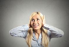 Stressed woman covering her ears Royalty Free Stock Image