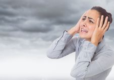 Stressed Woman by dark clouds Stock Images