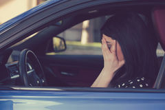 Stressed woman driver sitting inside her car royalty free stock images