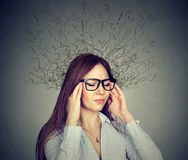 Stressed woman having headache has worried face expression. Portrait stressed young business woman having headache with worried face expression and brain melting Royalty Free Stock Images