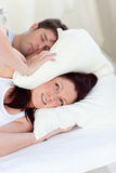Stressed woman with head under the pillow Royalty Free Stock Photos