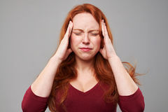 Stressed woman with headache holding her hands on head Stock Photography