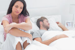 Stressed woman in her bed Stock Images