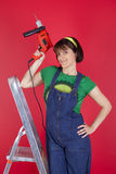 Stressed woman holding a electric drill Stock Images