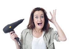 Stressed woman holding hair dryer Royalty Free Stock Image