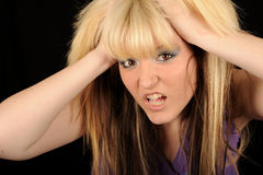 Stressed woman holding head Stock Images