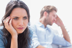 Stressed woman holding her head Royalty Free Stock Photos