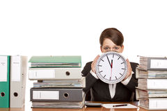 Stressed Woman i office with time pressure. Woman in office is stressed because of time pressure. Isolated on white background Royalty Free Stock Photo