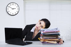 Stressed woman with laptop and paperworks Royalty Free Stock Image