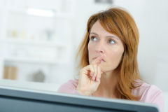 Stressed woman looking at computer screen Stock Photography