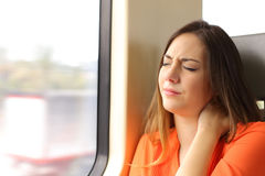 Stressed woman with neck ache in a train wagon Royalty Free Stock Photography