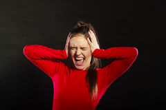 Stressed woman not listening covering ears. Royalty Free Stock Image