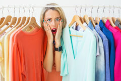 Stressed woman with nothing to wear Stock Photo