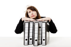 Stressed woman at the office stock photography