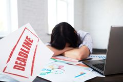 Stressed woman in office thinking about deadline. Stock Images