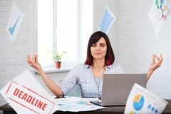 Stressed woman in office thinking about deadline. Stock Photography