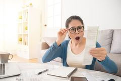 Stressed woman is panicking checking bills Royalty Free Stock Image