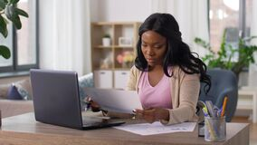 Stressed woman with papers working at home office