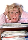 Stressed woman with paperwork Royalty Free Stock Photos