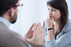 Stressed woman with personal coach. Image of stressed women during meeting wuth personal coach Royalty Free Stock Photos